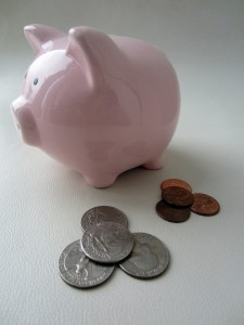 Piggy bank and some coins